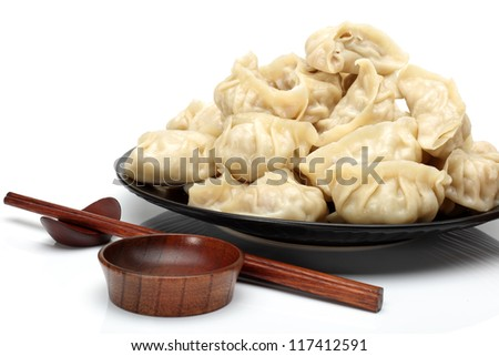 Chinese dumplings on white background
