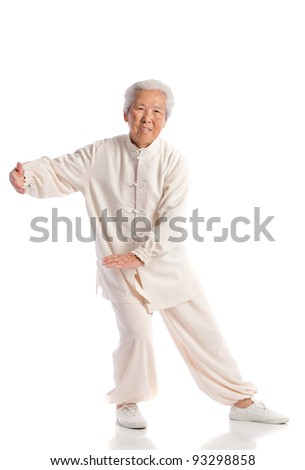 Chinese Elderly Woman Performing Tai Chi Isolated on White Background - stock photo