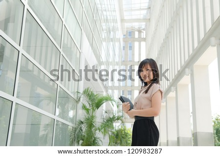 chinese female student in formal wear - stock photo