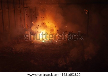 Chinese Firecrackers exploding in a backyard. #1431653822