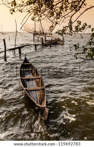 Chinese fishing net and fishing boat in Cochin (Kochi), Kerala, India