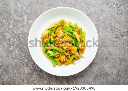 Chinese food, a dish of fried scallop meat with celery Photo stock ©