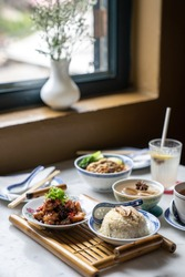 Chinese food set. Fried Chicken with sweet and sour sauce and steamed rice, Chinese noodles, Chinese soup. Chinese restaurant concept.
