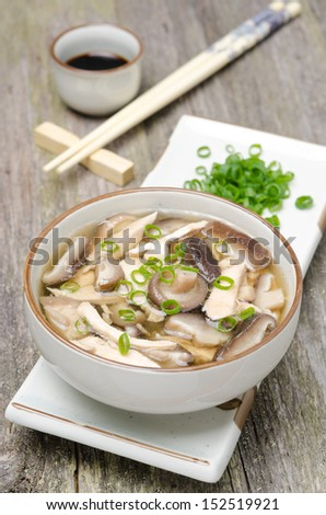 Chinese food - soup with chicken, shiitake mushrooms and green onions