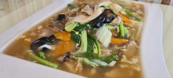 Chinese food vegetarian Cantonese Fried Flat Noodles in Egg Gravy known as Wa Tan Hor