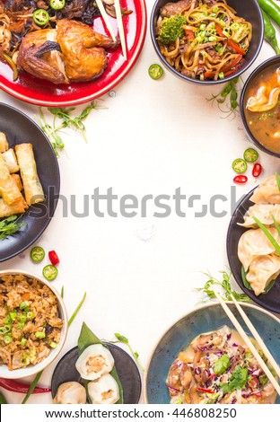 Chinese food white background. Chinese noodles, fried rice, dumplings, peking duck, dim sum, spring rolls. Famous Chinese cuisine dishes set. Space for text. Top view. Chinese restaurant concept