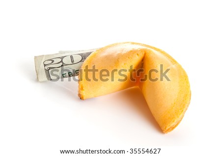 Chinese fortune cookie with a US 20 dollar bill inside.  Metaphor for American and Chinese partnership, trade, or debt.  Isolated.