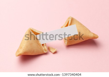 Chinese fortune cookies. Cookies with empty blank inside for prediction words. Pink background ストックフォト ©