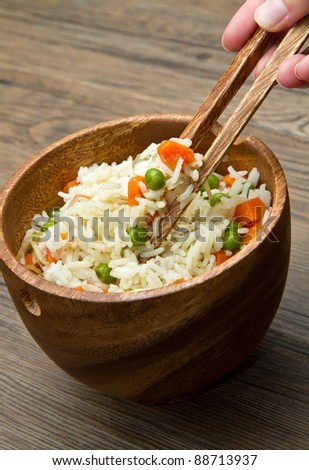 Chinese fried rice with carrots, peas and soybeans