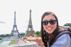 Chinese girl got a souvenir in paris