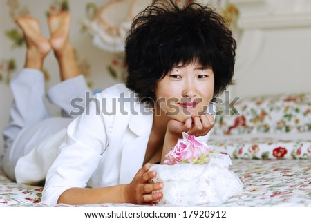 Chinese girl thinking on bed