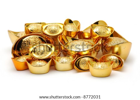 Chinese gold ingot ornaments in isolated white background