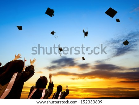 Chinese graduates and sunset sky.