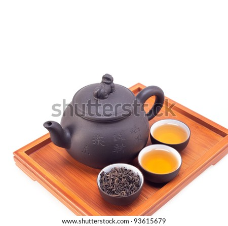 chinese green tea clay pot and cups on bamboo wood tray isolated over white - stock photo