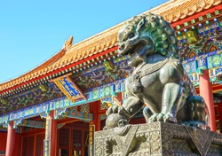Chinese guardian lion. People are visiting. Located in The Palace Museum (Forbidden City), Beijing, China.