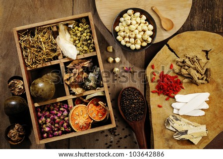 Chinese herbal medicine and flower tea on wooden