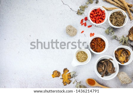 Chinese herbs with copy space and flat lay composition. Variety of dried tea, dried herbal, green, black tea and fruit tea. Table top view.