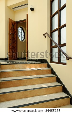 Chinese home interior with staircase, door and window