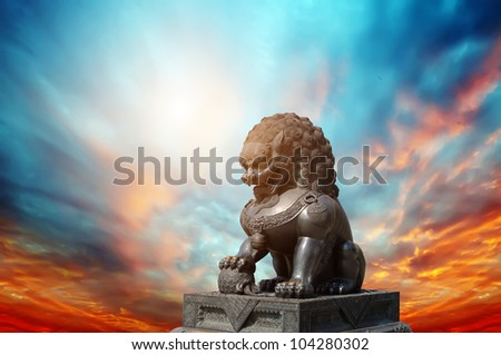 Chinese Imperial Lion Statue at sunset