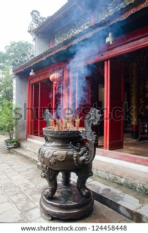 Chinese incense burner and traditional temple.