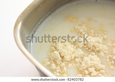 Chinese ingredient, almond powder and milk in pot for cooking the Almond tofu