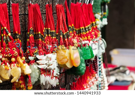 Chinese Jade Charms were sold along Yaowarat street, China town, Thailand. Chinese Jade Charms are popular for tourists who buy them as souvenirs and gifts with meaning of luck.