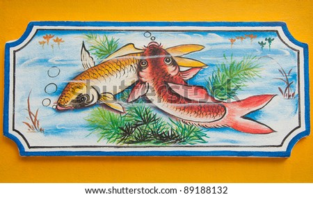 chinese koi fish painting on wall in chinese temple