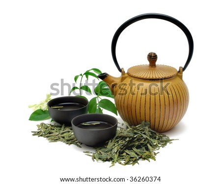 Chinese Long Jing green tea with small pot and cups isolated on white - stock photo