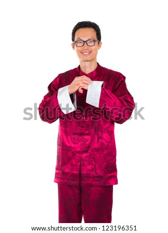 chinese man in traditional suit in chinese greeted isolated in white