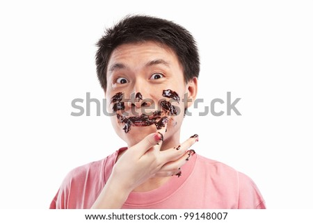 Chinese man which his face spread of chocolate, isolated on white background