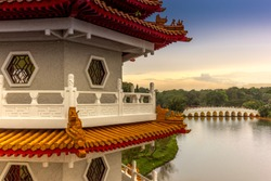 Chinese marble bridge temples reflecting in the lake in the Chinese garden in Singapore - 5