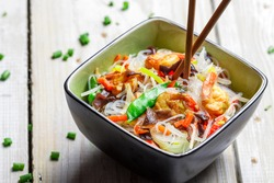 Chinese mix vegetables and rice noodles on old wooden table