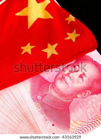 Chinese money with a chinese flag - stock photo