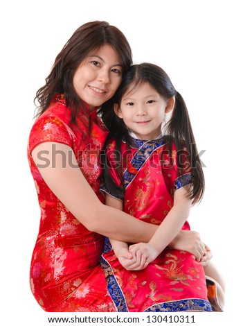 Chinese mother and daughter in traditional china dress isolated on white background
