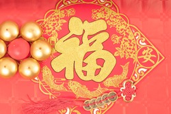 Chinese new year decoration,  candles on a red table, ancient Chinese coins from  Qing period,Translation
