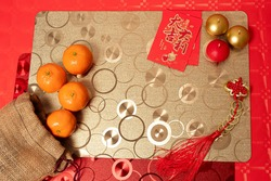 Chinese new year decoration red table, tablecloths and tangerines ancient Chinese coins from  Qing period,Translation
