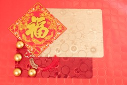 Chinese new year decoration red table, tablecloths, candles, ancient Chinese coins from  Qing period,Translation