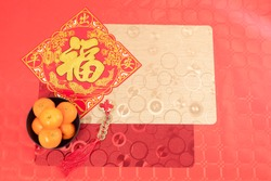 Chinese new year decoration red table, tablecloths, tangerines ancient Chinese coins from  Qing period,Translation