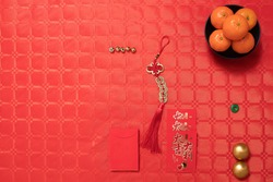 Chinese new year decoration red table, tablecloths, tangerines,  ancient Chinese coins from  Qing period, Translation