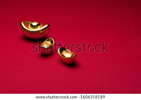 Chinese New Year decorations in red background with assorted festival decorations. Chinese characters in decoration means generous of wealth, prosperity and luck.