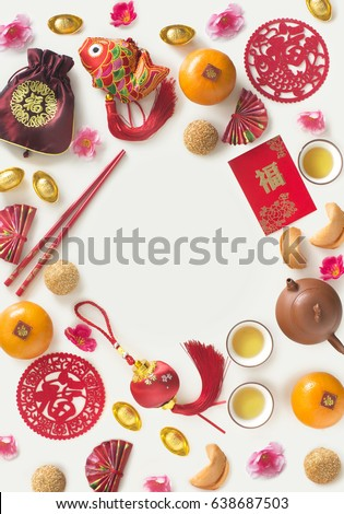 """Chinese new year decorative item with """"prosperity""""  wording and food on white background. Flat lay text space image."""