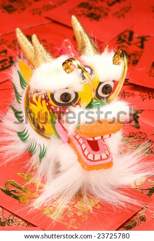 Chinese New Year Dragon Decoration on red envelopes.