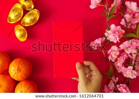 """Chinese new year festival.Celebration Chinese new year or lunar new year.People Giving red envelope.Text space images. (with the character """"fu"""" meaning fortune Prosperity and Spring going smooth."""
