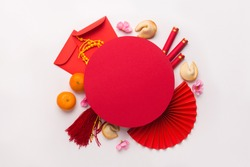 Chinese New Year flat lay white background with assorted festival decorations. Wishing wealth, prosperity and luck, copy space