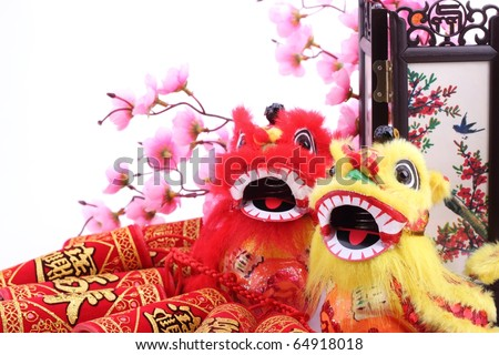 Chinese new year ornament--Tradition al dancing lions,firecrackers, screen and plum blossom. - stock photo