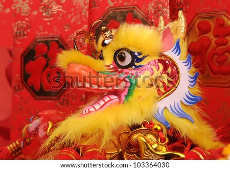 Chinese New Year Ornaments--Traditional Dancing Dragon,Money Red Packet - stock photo