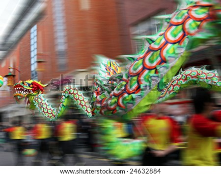 Chinese New Year Parade with Motion Blur as the Dragon speeds and twirls through City Streets to bring in year of the Ox