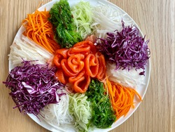 Chinese New Year Prosperity Toss with assorted shredded vegetable, seaweed and smoked salmon