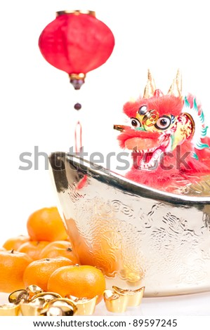 Chinese new year with dragon decoration, large gold ingot,red lantern and mandarin oranges