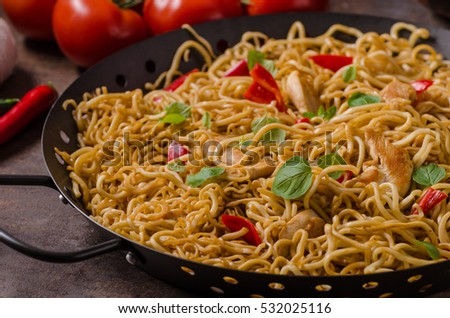 Chinese noodles chicken, hot peppers and garlic in